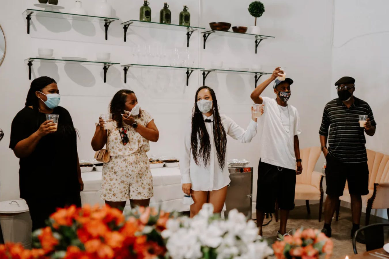 Friends and family in masks toast to couple at intimate 40th wedding anniversary party | PartySlate