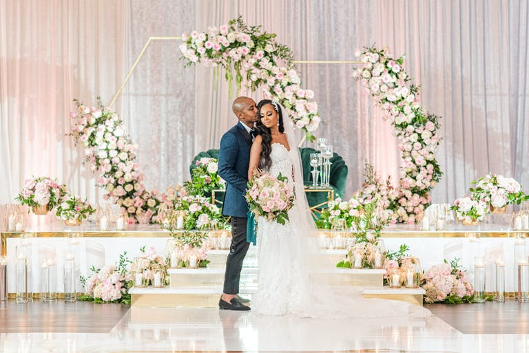 Beautiful White Wedding With Blush-Toned Crescent Floral Backdrops Designed by BCG Events   PartySlate
