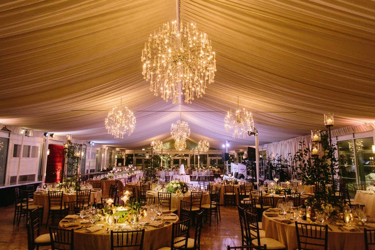 cream hued draped ceiling with starburst chandeliers over wedding reception in Chicago   PartySlate