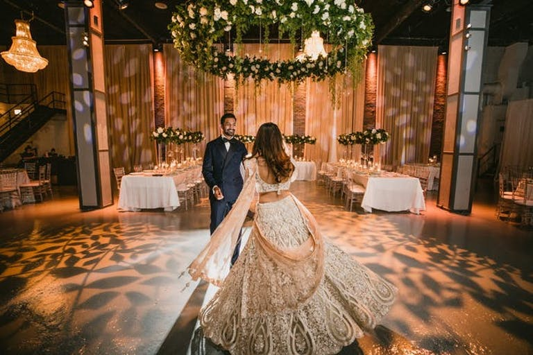 wedding first dance with leafy lighting and greenery ceiling decoration in Chicago   PartySlate