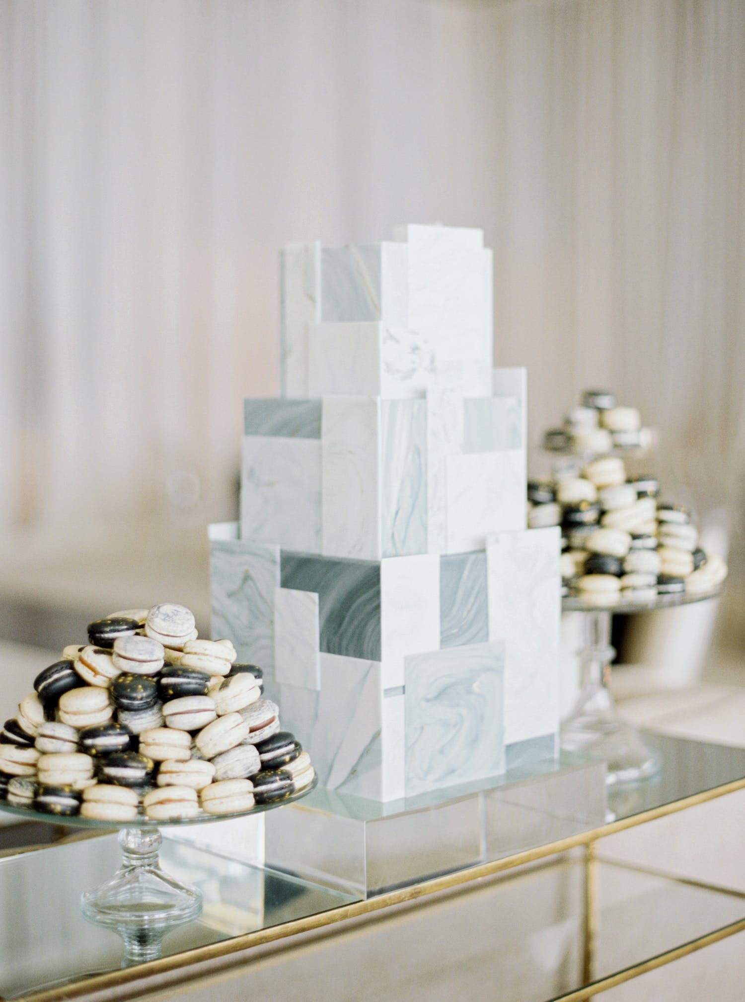 Three-tier grey cake made up of mismatched tile shapes with a marble design | PartySlate