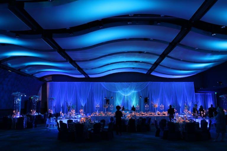 Blue Up-Lit Wedding Reception With Undulating Blue Ceiling at Georgia Aquarium in Atlanta, GA   PartySlate
