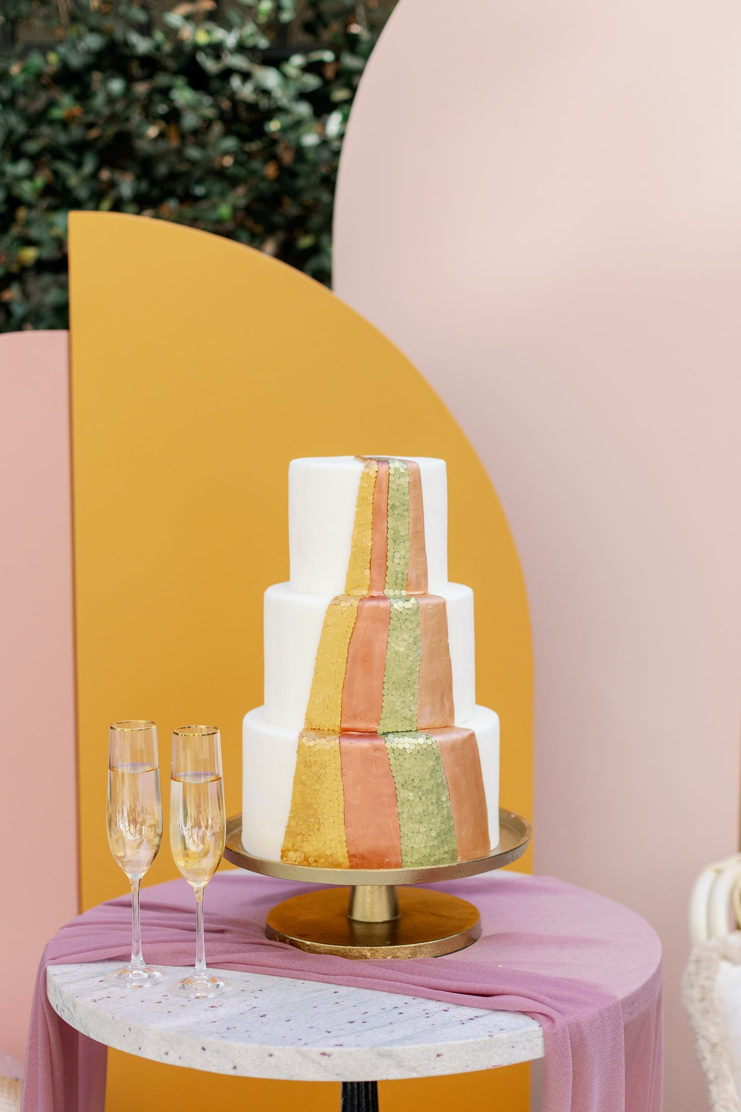 Three tier boho, 70s style wedding cake with multiple bright colors | PartySlate