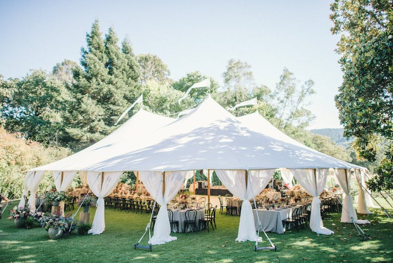 White canopied reception area on manicured lawn surrounded by greenery at Annadel Estate Winery in Santa Rosa, CA   PartySlate