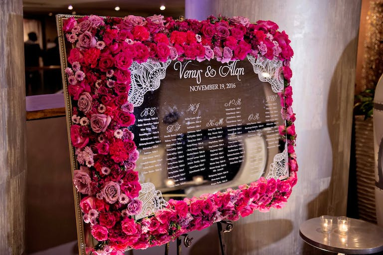Mirrored Seating Chart Framed in Bright Pink Flowers Designed by Keisha's Kreations of Houston, TX   PartySlate