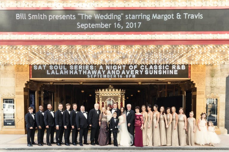 Wedding Party Stand in Front of The Fox Theatre with Personalized Marquee Signage in Atlanta, GA   PartySlate