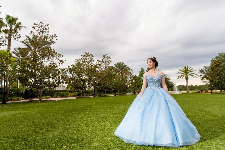 Quinceañera wears blue Cinderalla-style ballgown for her quinceañera celebration | PartySlate