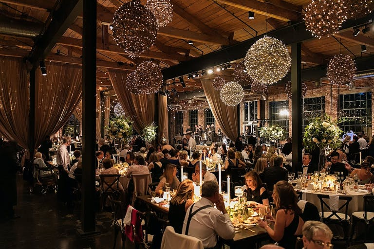 Wedding Reception with Orbed Rustic Lighting at The Foundry at Puritan Mill in Atlanta, GA   PartySlate