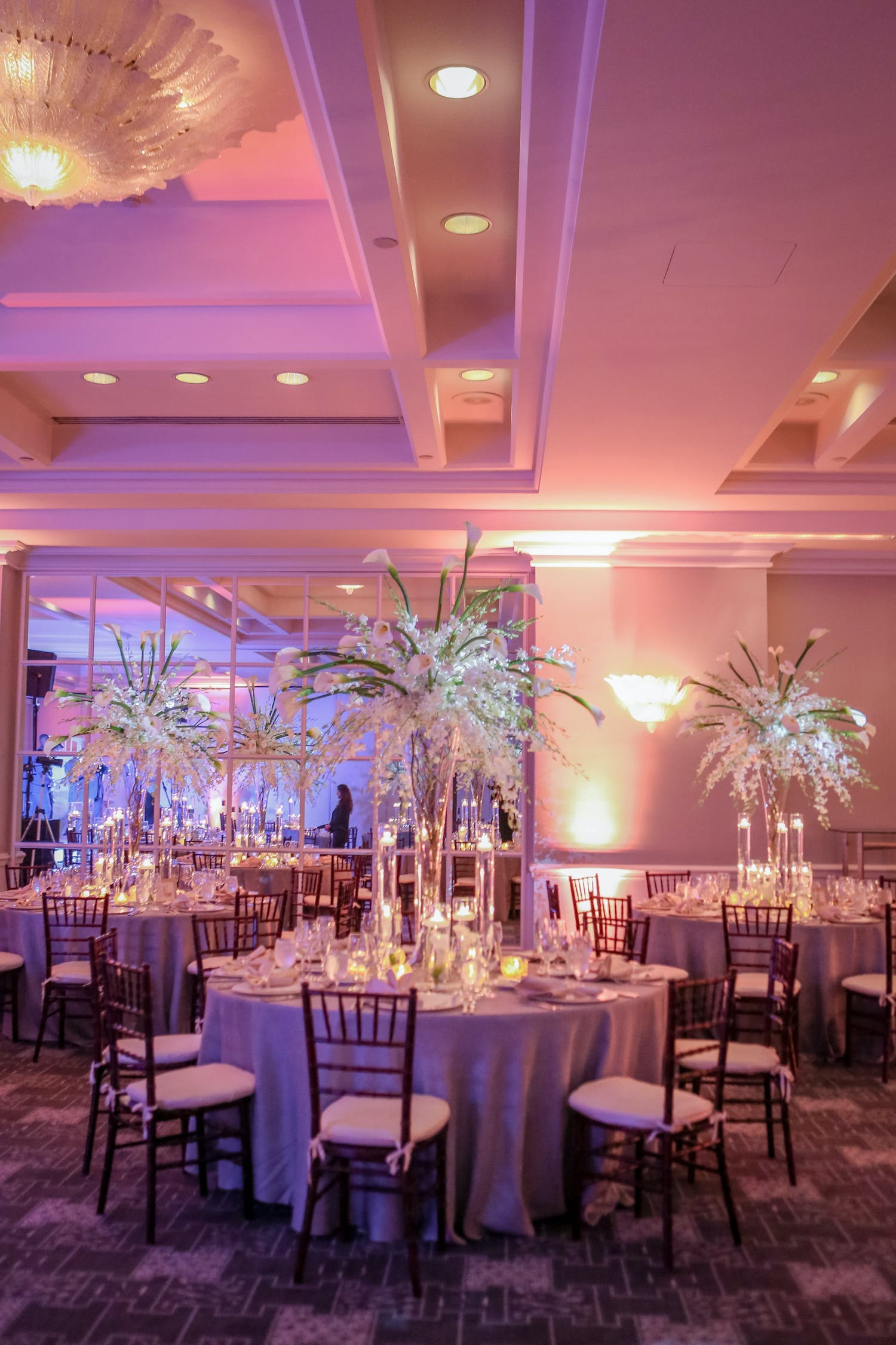 Pink uplit ballroom wedding planned by Signature Events by Abby | PartySlate