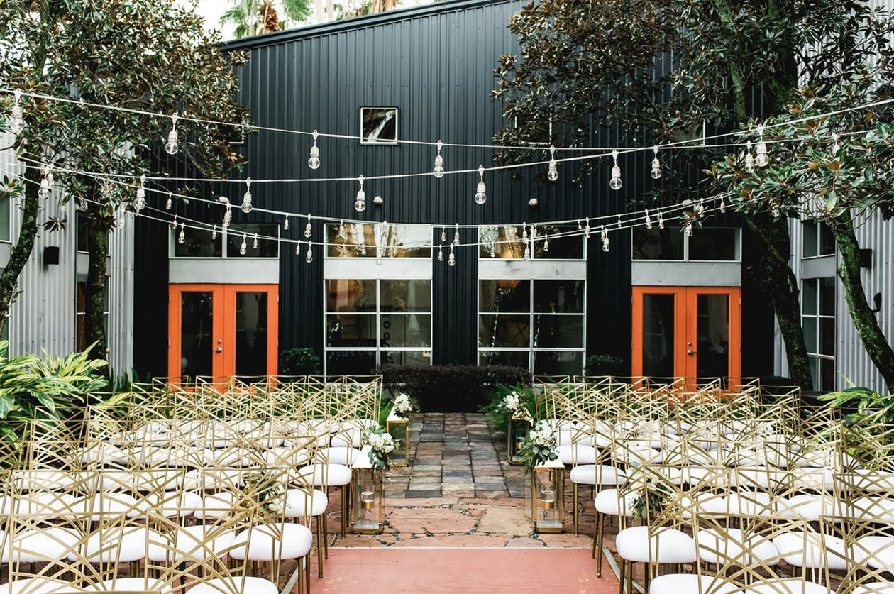 Outdoor wedding with string lights at the courtyard at 5226 ELM, one of PartySlate's favorite small Houston wedding venues   PartySlate