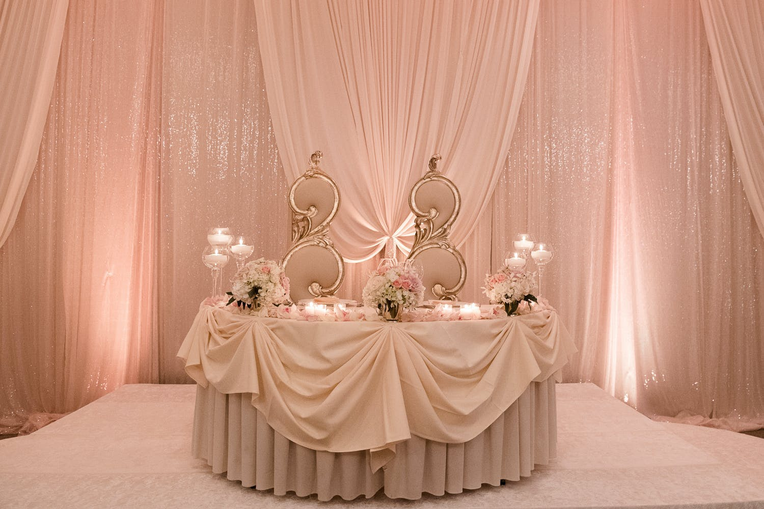 Pink and Gold Sweet Heart Table with Pink, Shimmery Backdrop at 60th-Anniversary Party | PartySlate