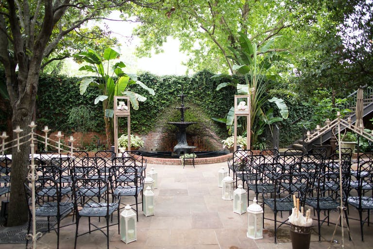 Outdoor wedding reception in romantic courtyard with greenery at Brennan's of Houston   PartySlate
