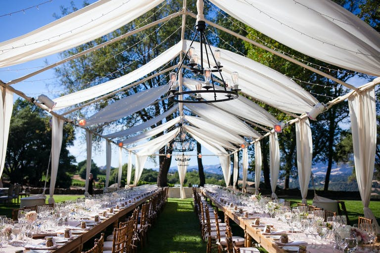 Outdoor reception under the shade of draping white tapestry at Chalk Hill Winery in Sonoma   PartySlate