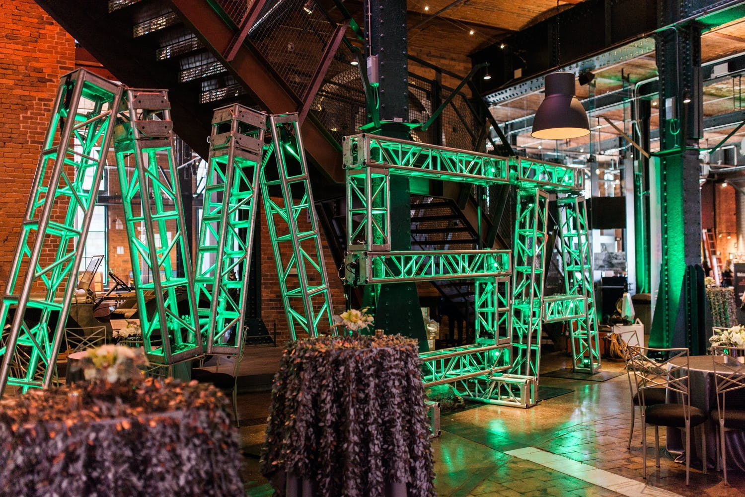Mine Safety Appliances Company's 100 Year Celebration with Green Geometric Décor Uplit Structure Spelling Out MSA | PartySlate