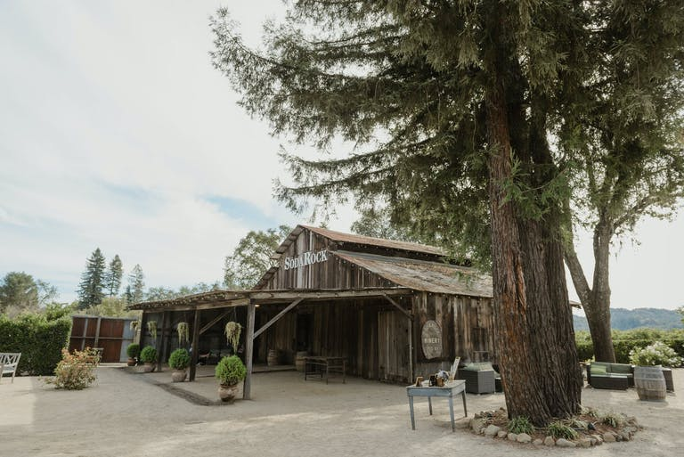 Soda Rock Winery's wooden barn surrounded by greenery   PartySlate