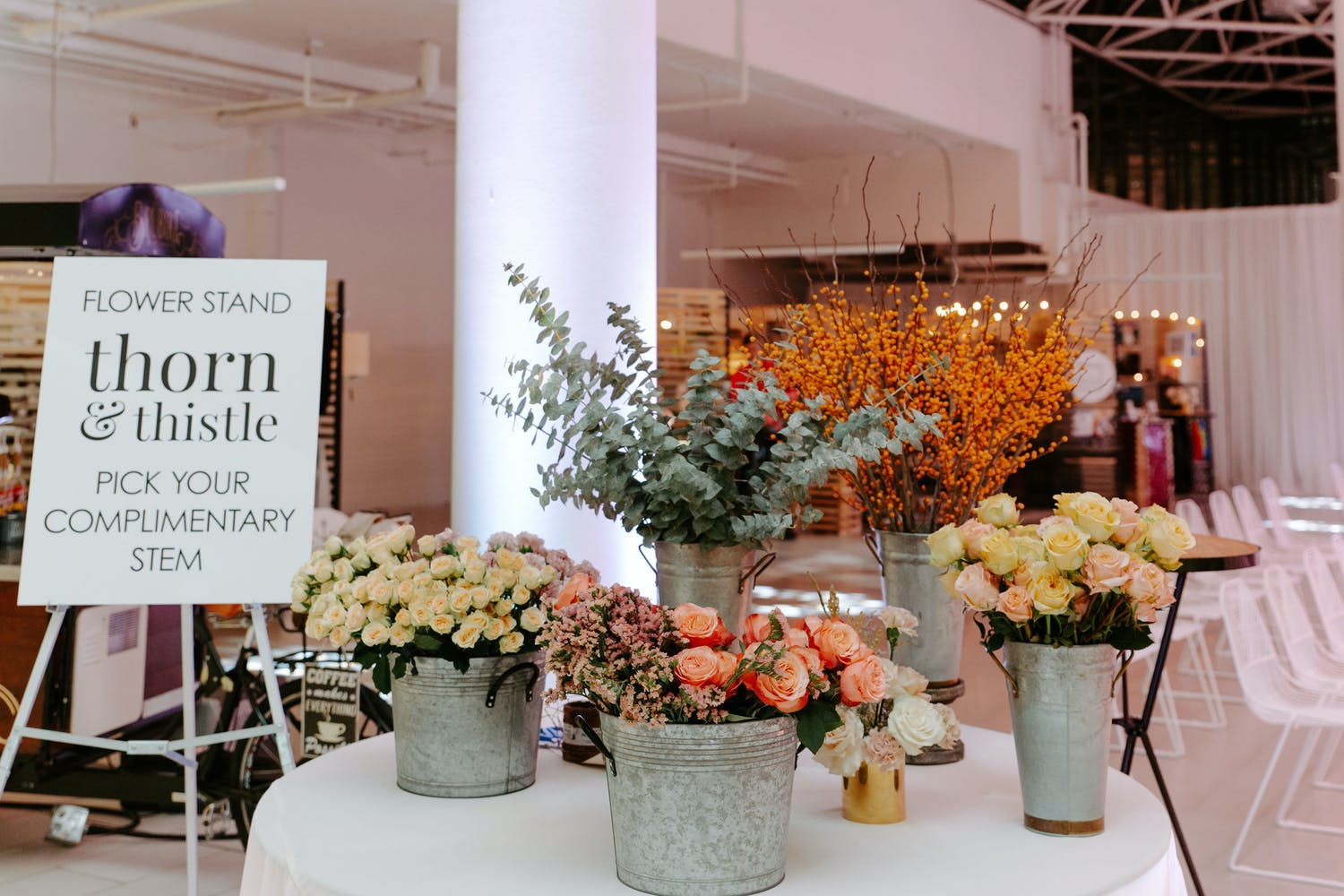 Flower stand where guests can pick a stem as a party favor at Mayfair Centre launch in Vancouver | PartySlate