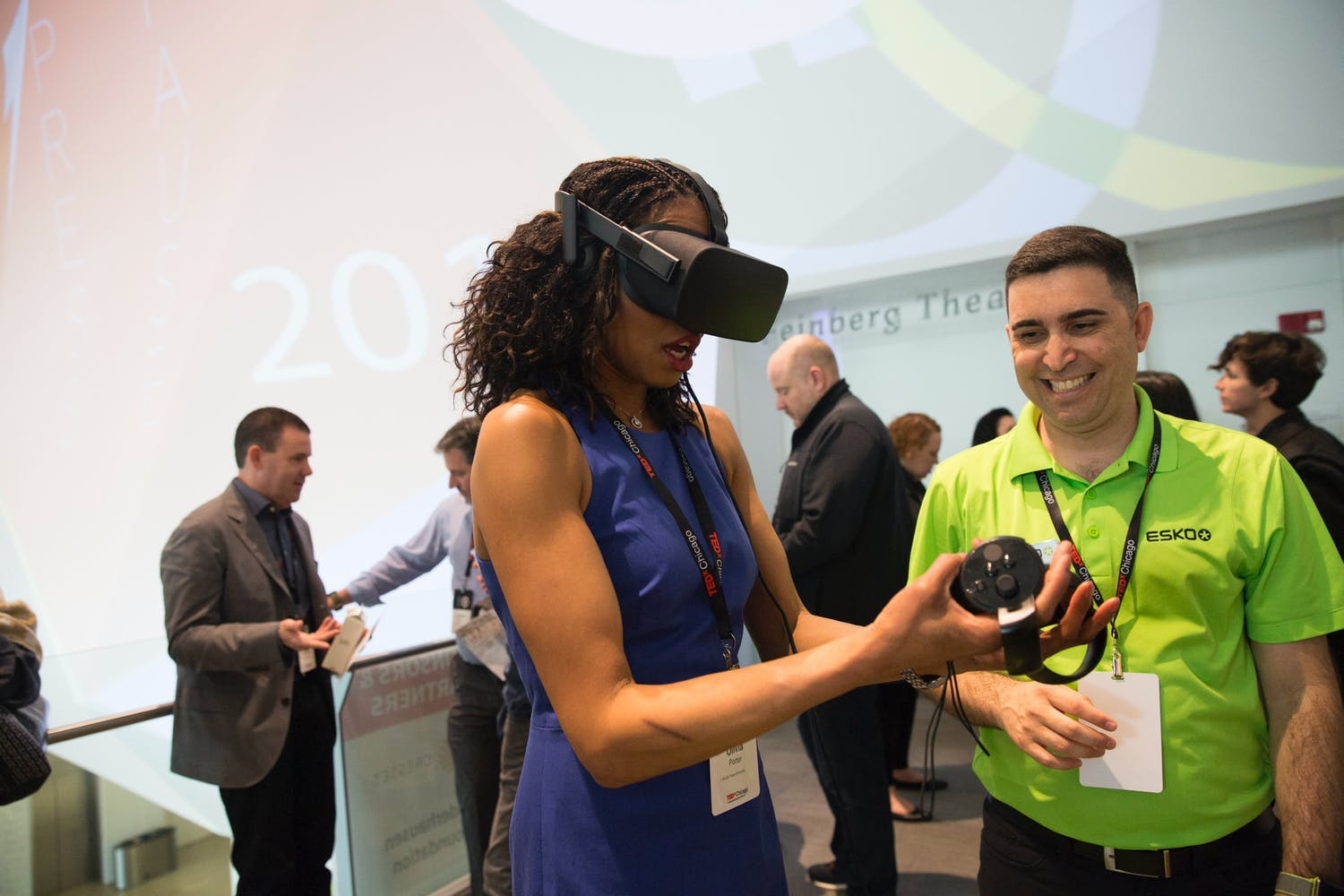 Guest tries on virtual reality headset at TEDxChicago 2019 | PartySlate