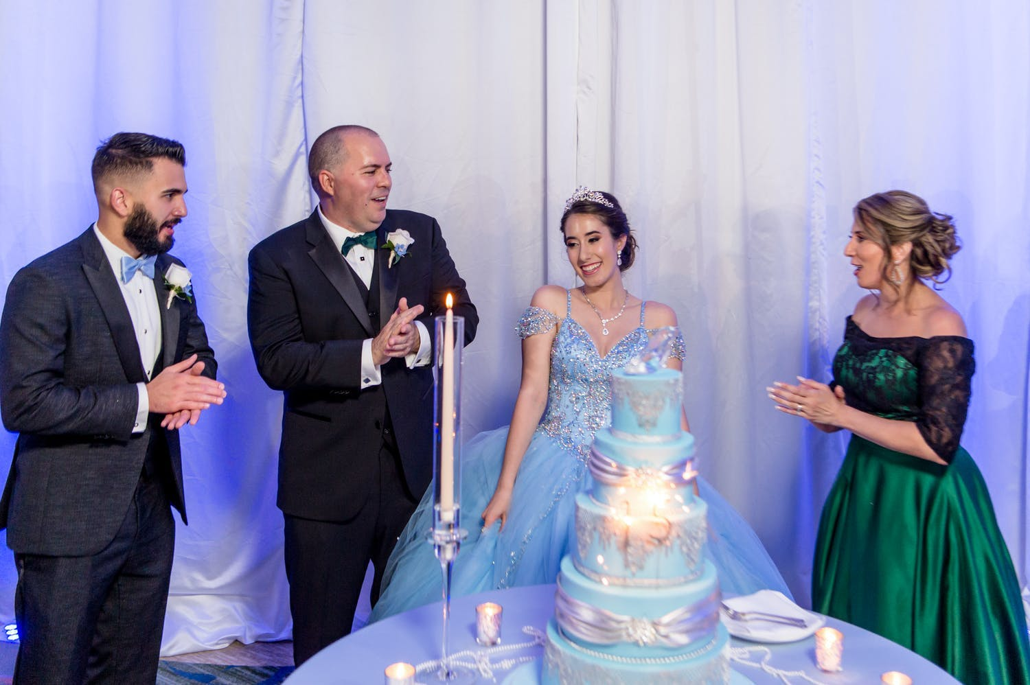 15 candle ceremony for quinceañera as she's watched by chambelan and parents | PartySlate
