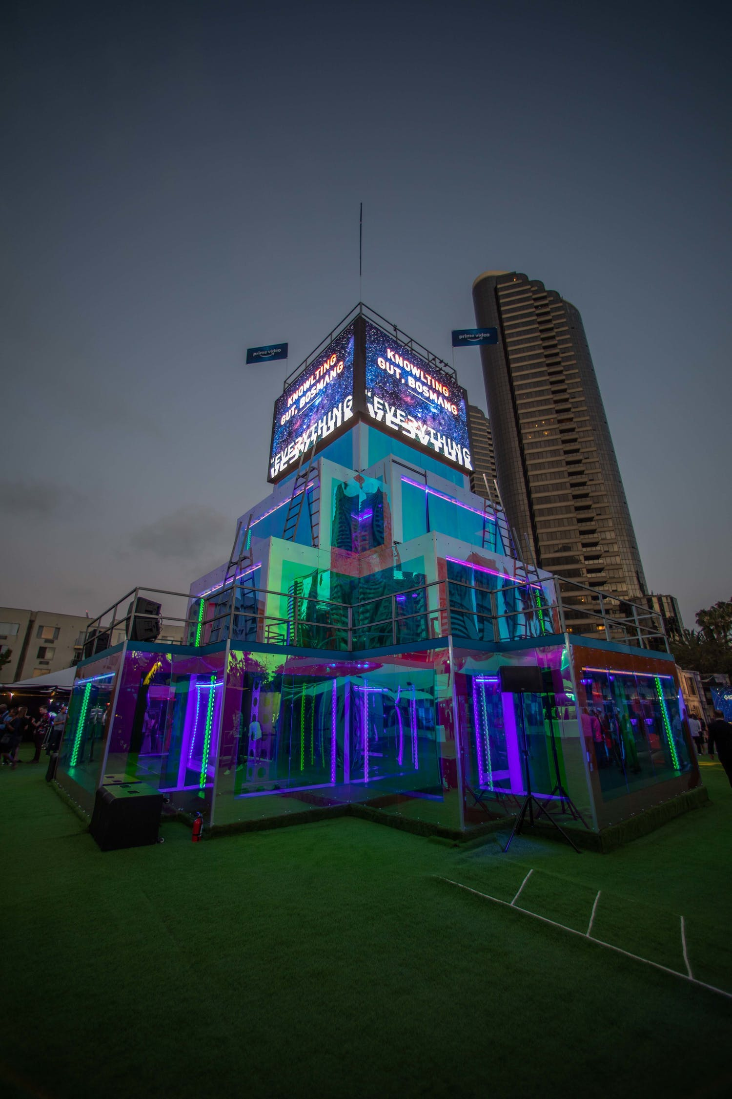 Taking place on a terrace in a city, LED screens are on top of a tower and colored screens are staggered on the rest for private event | PartySlate