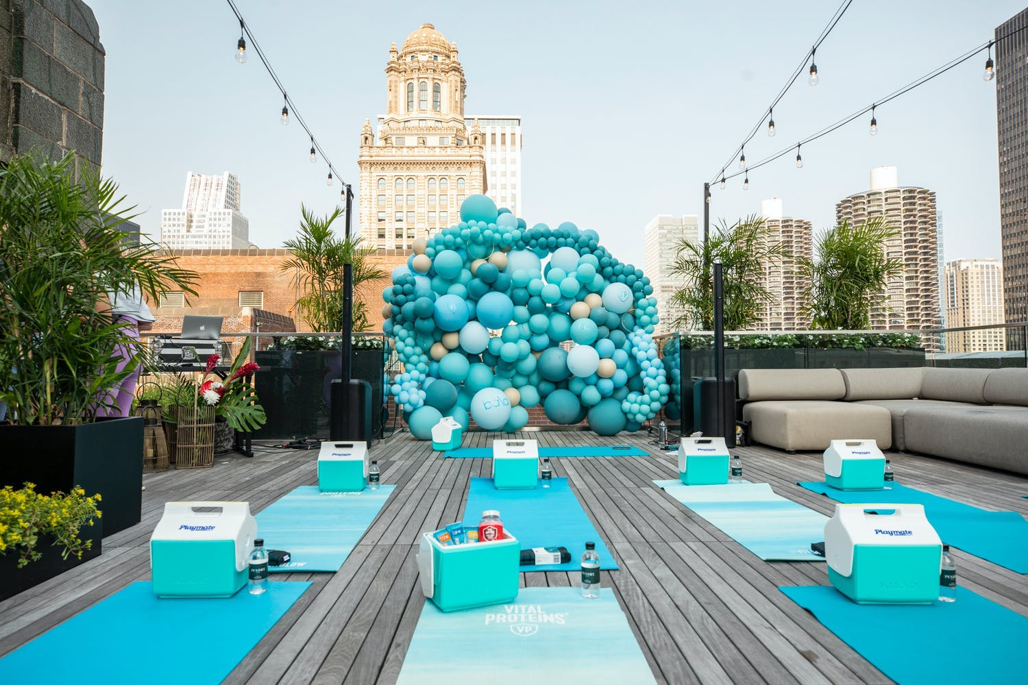 Corporate event with rooftop yoga session and blue décor | PartySlate