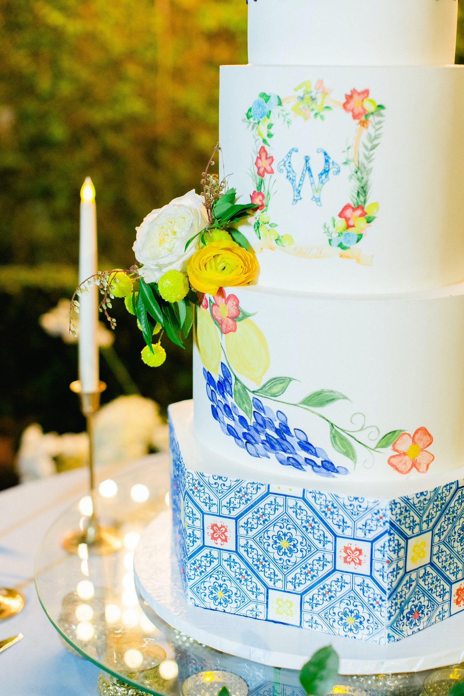 Five-tier French-inspired cake with blue accents and lemon designs | PartySlate