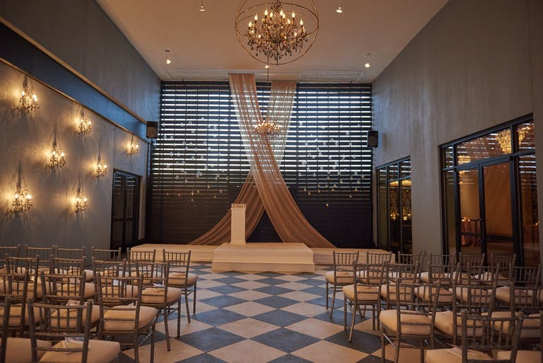 Modern Wedding Ceremony with Simple Sheer Drapery at Flourish by Legendary Events in Atlanta, GA   PartySlate