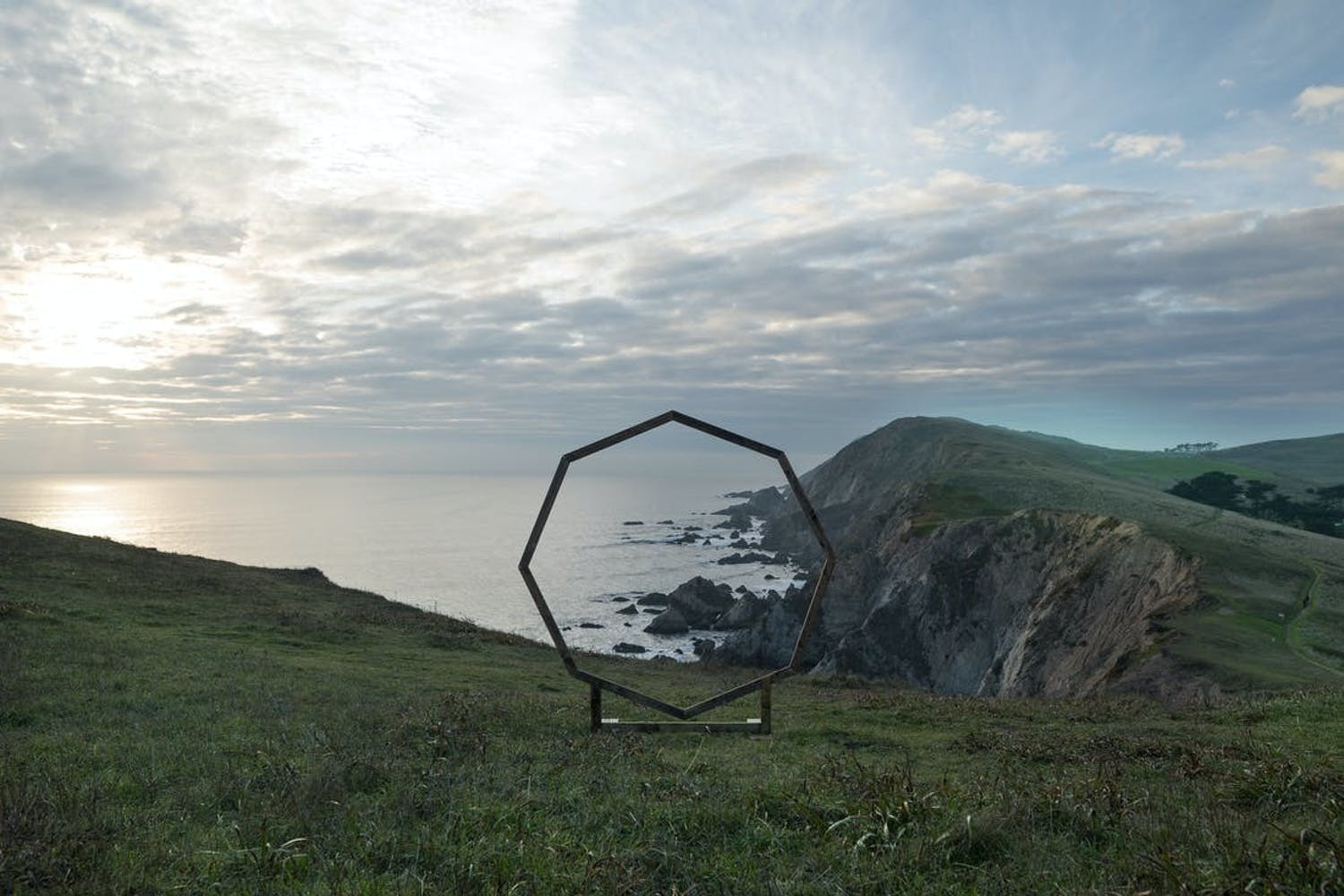 Octagonal wedding arch with views of the Marin Headlands of California | PartySlate