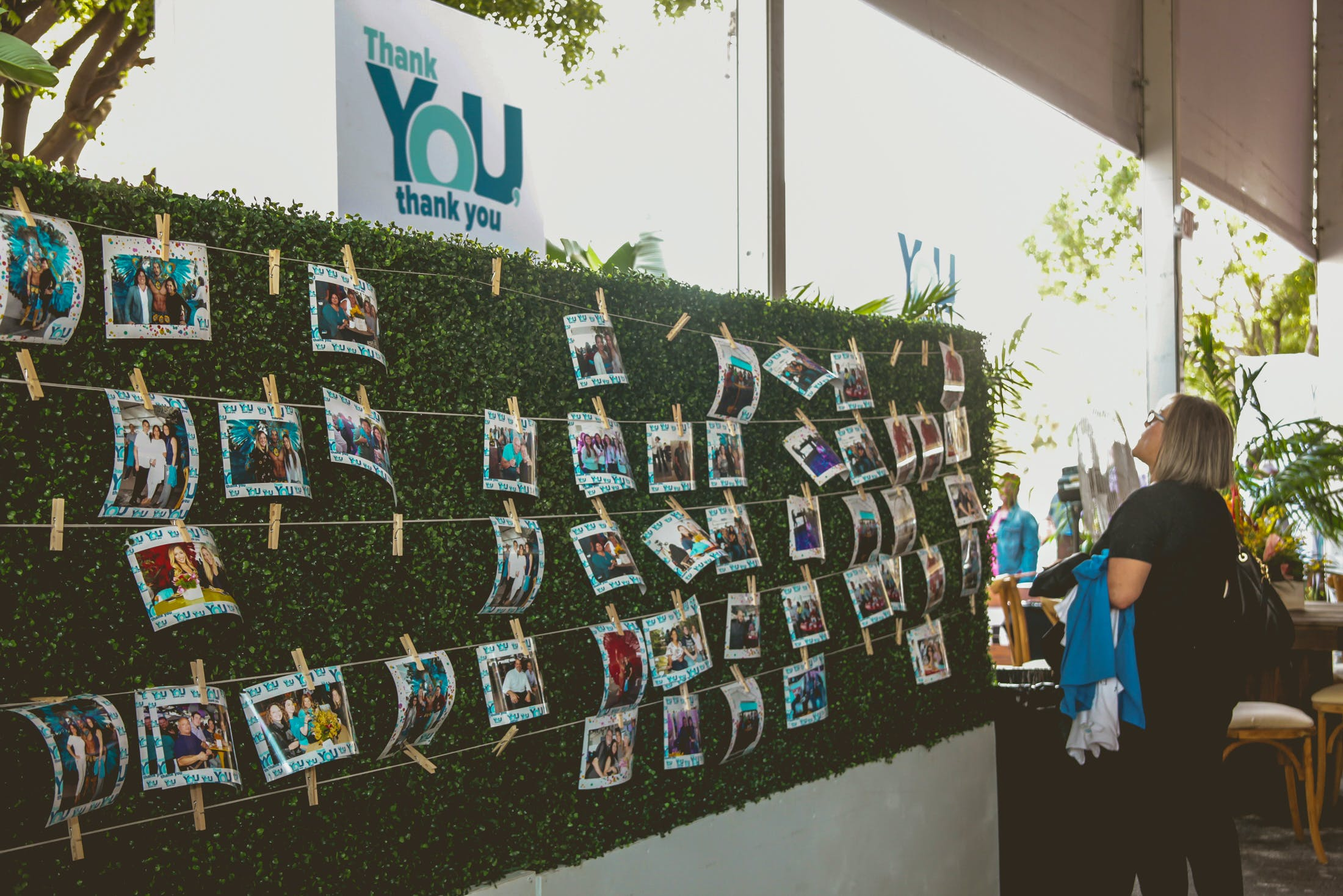 Find your photo wall covered in greenery at corporate event | PartySlate