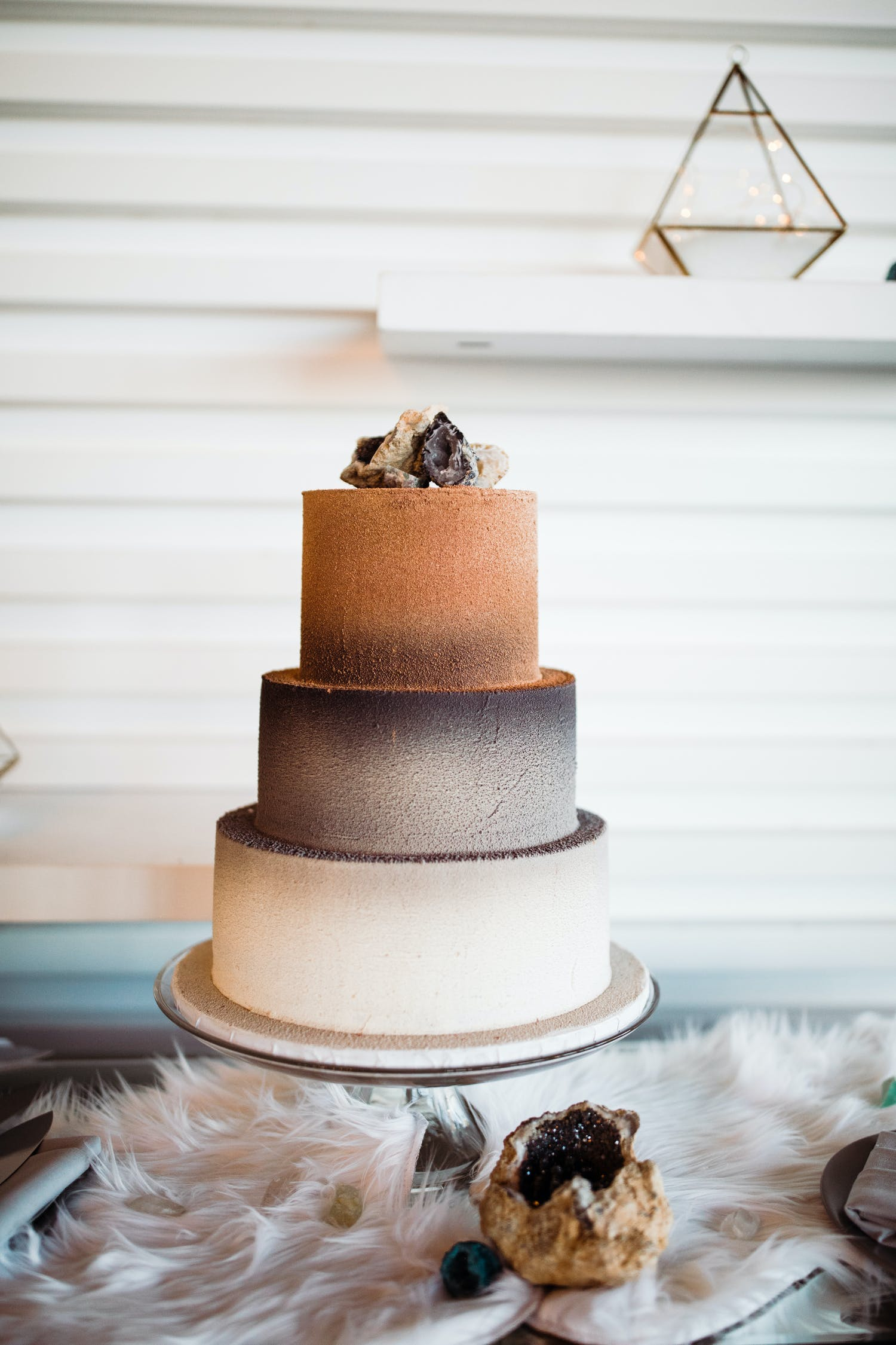 Three tier wedding cake with dusty orange, grey and white using gradient effect | PartySlate