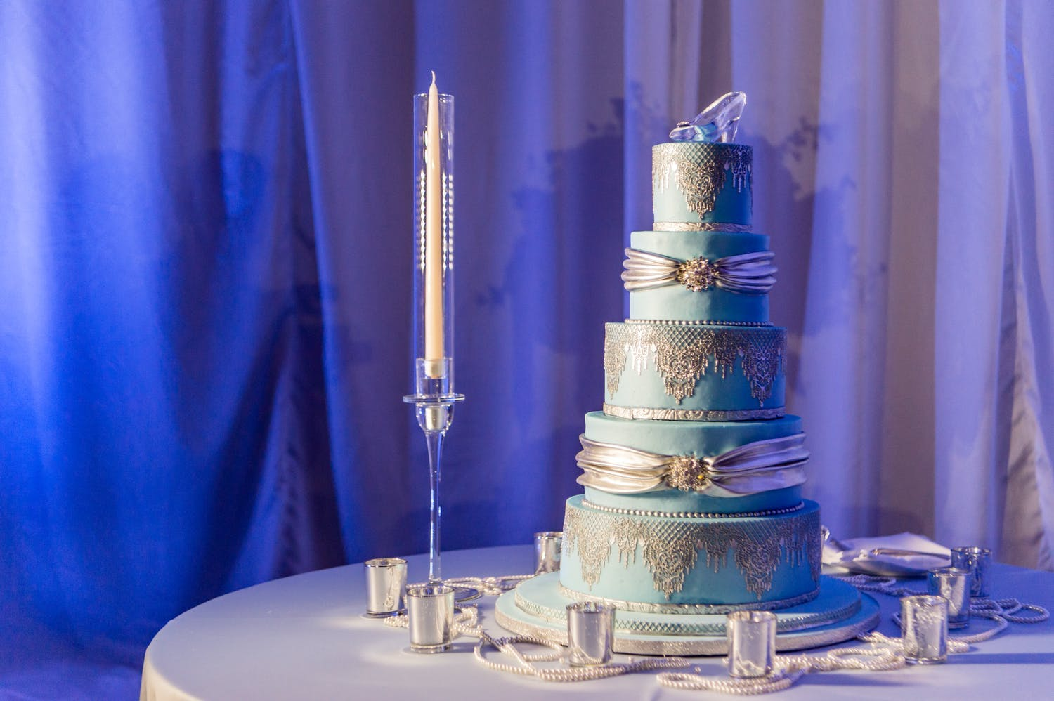Towering blue and silver Cinderella-themed quinceañera cake | PartySlate