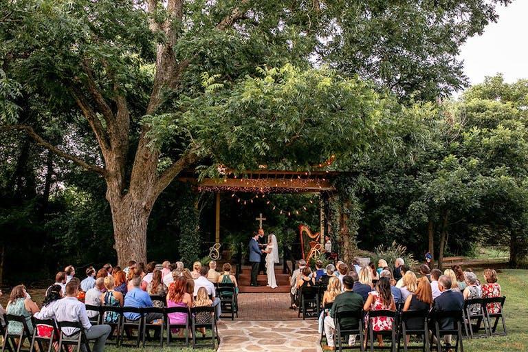 Christian wedding ceremony at Bernhardt Winery in Plantersville, TX   PartySlate