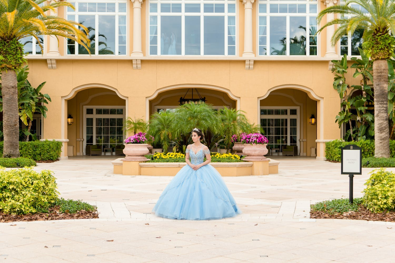 Quinceañera stands in front of The Ritz-Carlton Orlando, Grande Lakes, her reception venue | PartySlate