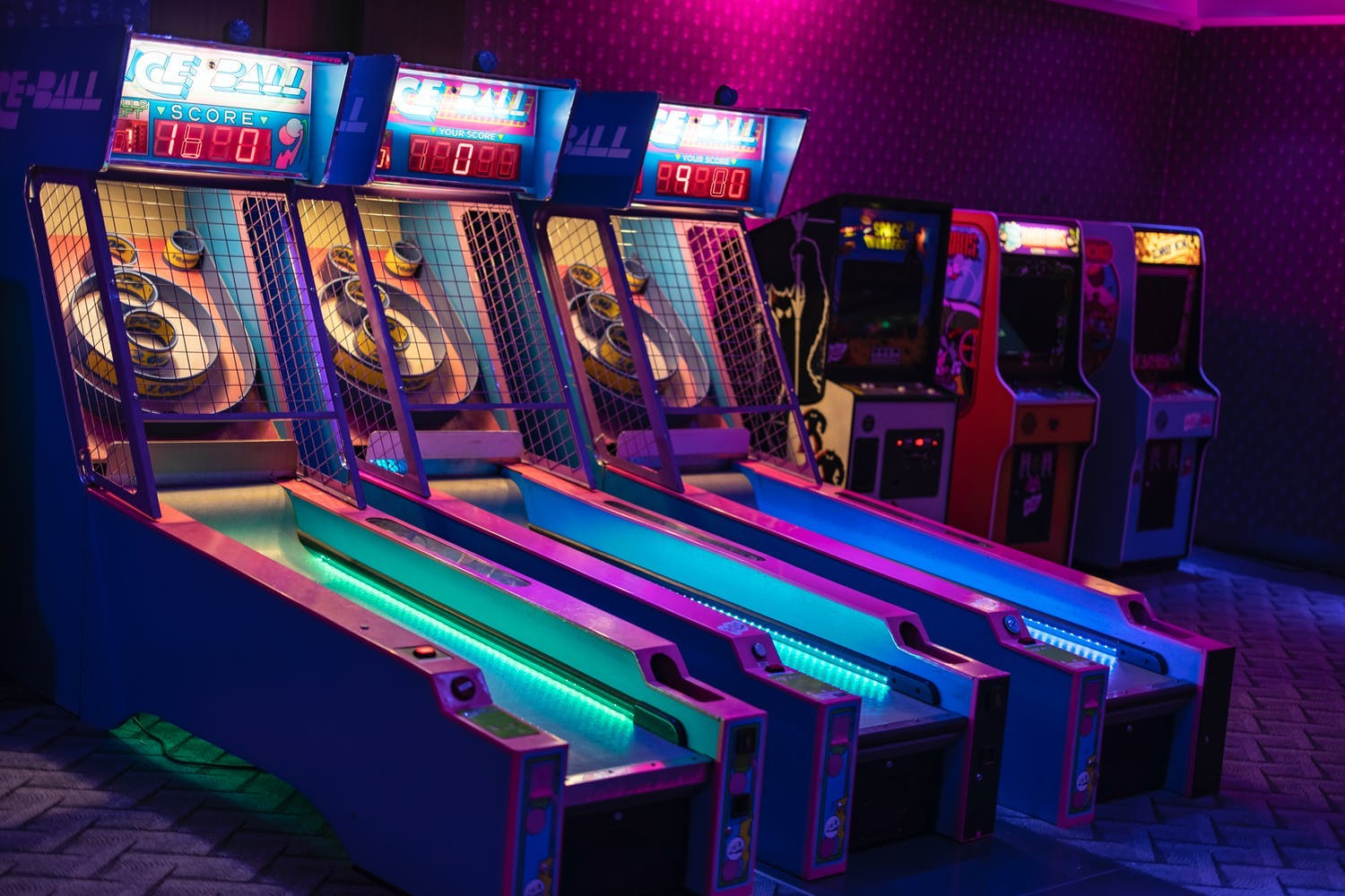 Neon skee ball arcade games at throwback 80s-themed corporate event | PartySlate