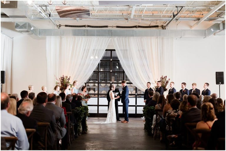 All-White Modern and Minimalist Wedding Ceremony at The Stave Room at American Spirit Works in Atlanta, GA   PartySlate