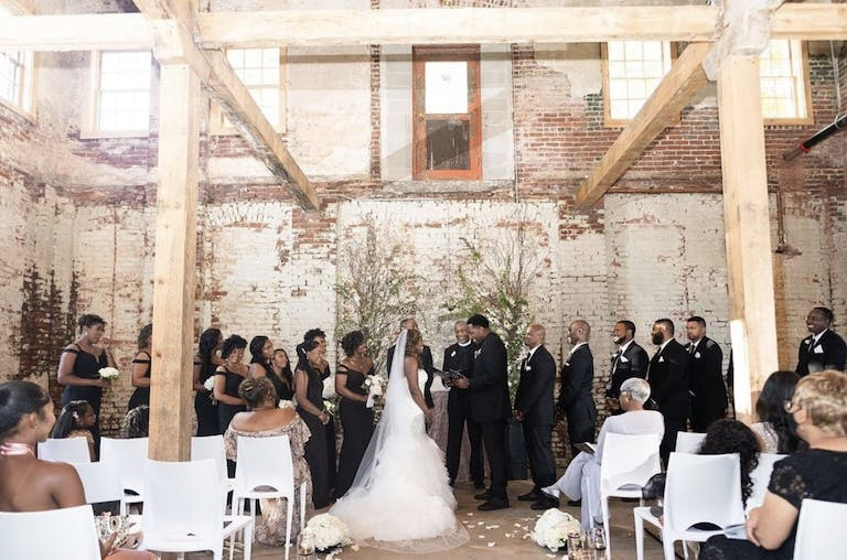 Indoor Wedding Ceremony with Minimal Greenery at Guardian Works at Echo Street West, an Industrial Raw Event Space in Atlanta, GA   PartySlate