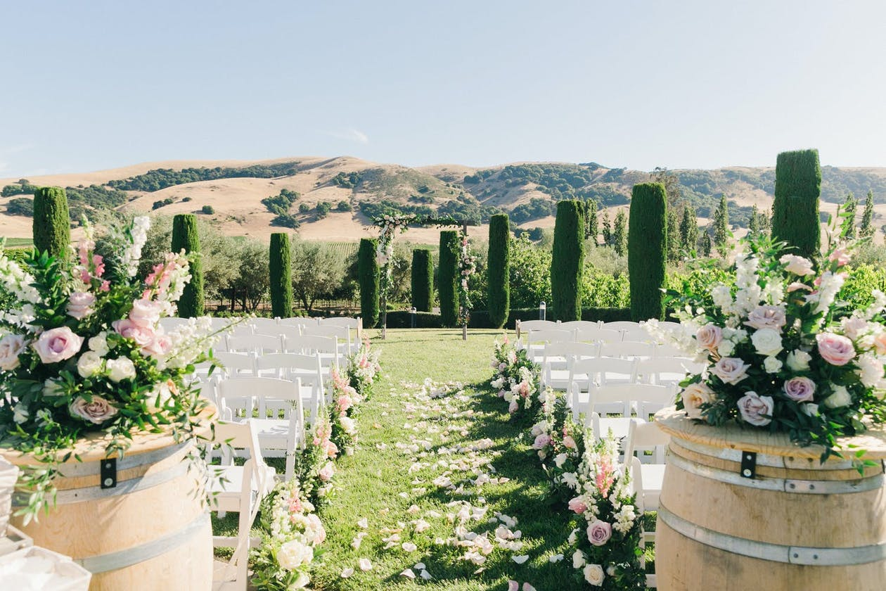 Pink and White Romantic Outdoor Ceremony at Viansa Sonoma, One of the Premier Winery Wedding Venues   PartySlate