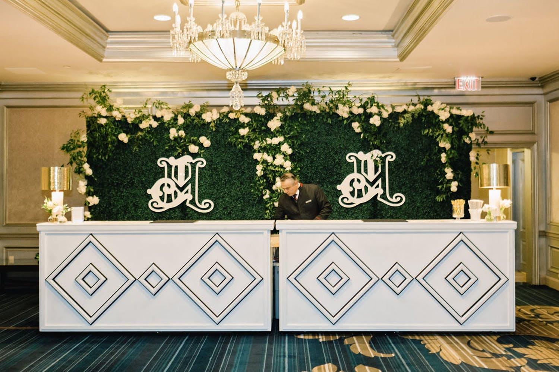White wedding bar with double diamond design and boxwood backdrop at the Ritz-Carlton Atlanta | PartySlate
