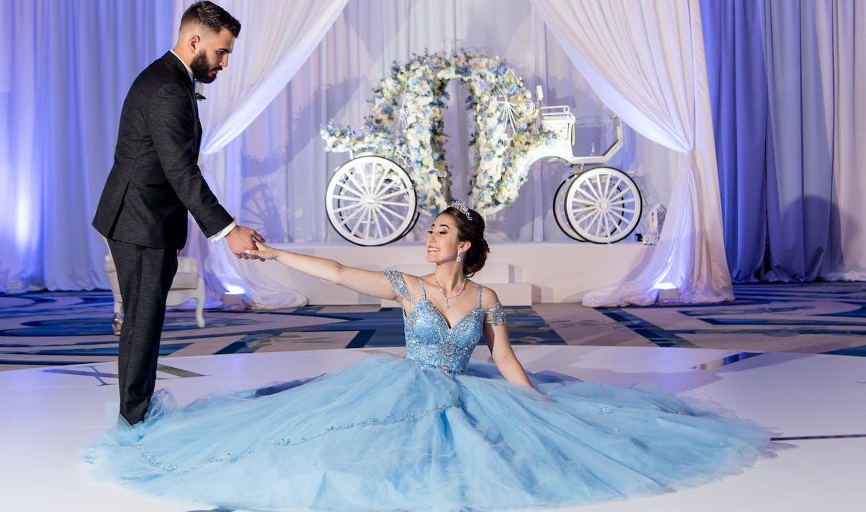 The chamberlain escort invites the quinceañera to dance | PartySlate
