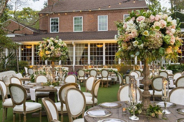 Outdoor wedding reception at The Manor House at The Houstonian Hotel Club & Spa   PartySlate