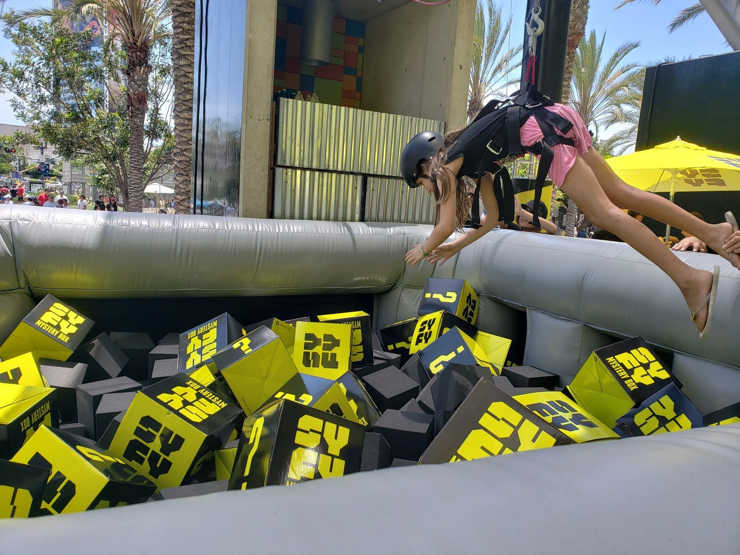 Human claw machine, one of PartySlate's most creative corporate event ideas | PartySlate