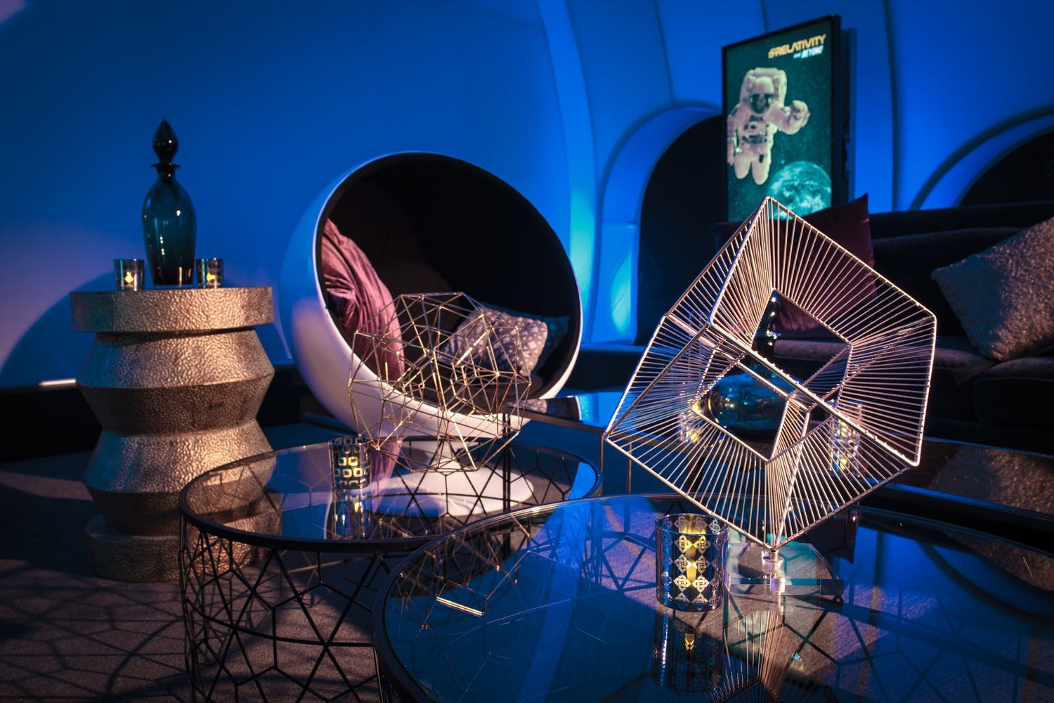 Futuristic lounge area with geometric décor at space-themed corporate holiday party | PartySlate