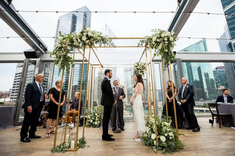 Micro wedding ceremony at Gibsons Italia with Spectacular City Views   PartySlate
