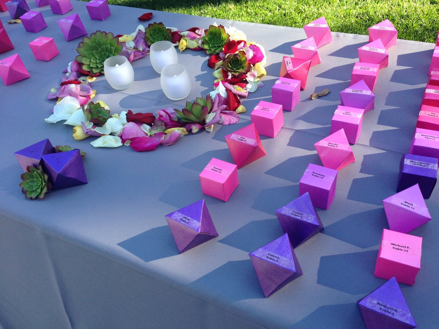Garden wedding with pink and purple geometric origami wedding escort cards | PartySlate