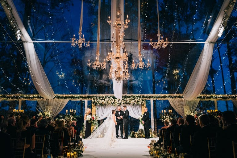 Evening Winter Wedding Ceremony in Transparent Tent With Glittering Chandeliers at The Ritz-Carlton Reynolds, Lake Oconee in Greensboro, GA   PartySlate