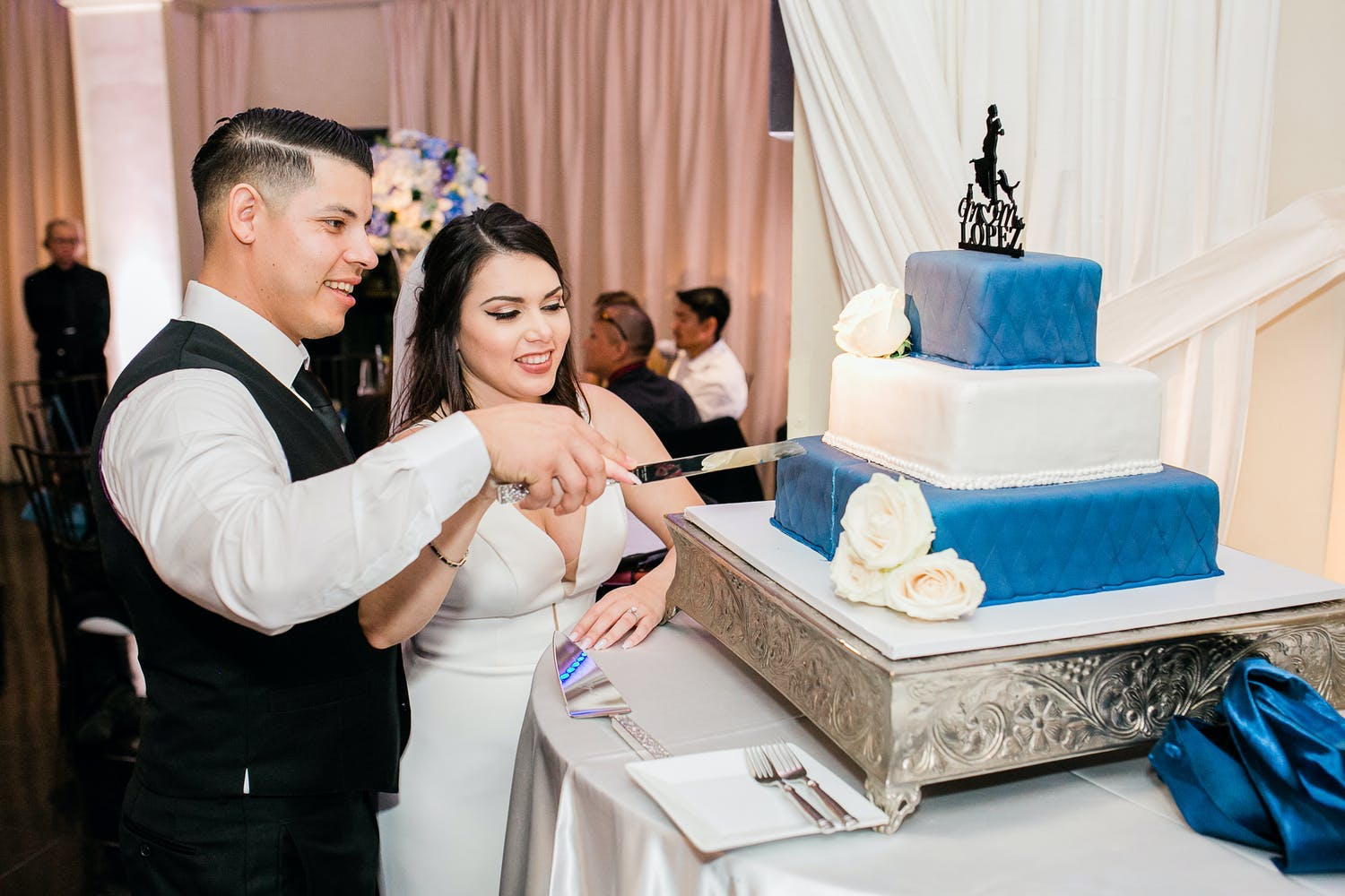 Three-tier wedding cake with dark blue on top and bottom and white in middle | PartySlate