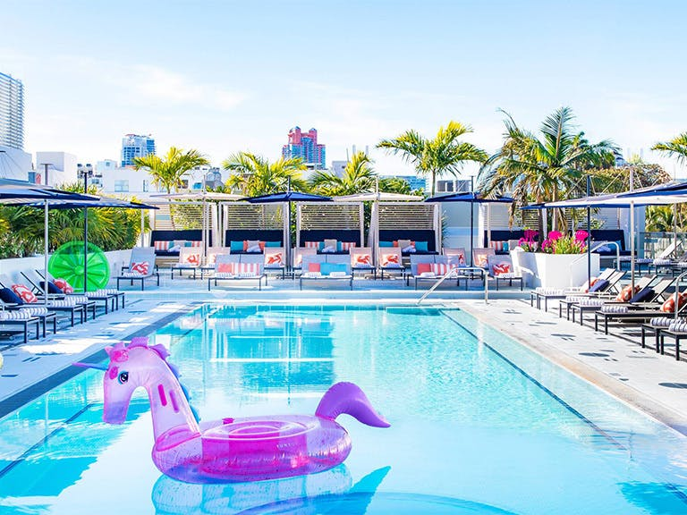 Pool with Purple Unicorn Floating Devise at Moxy Miami South Beach | PartySlate