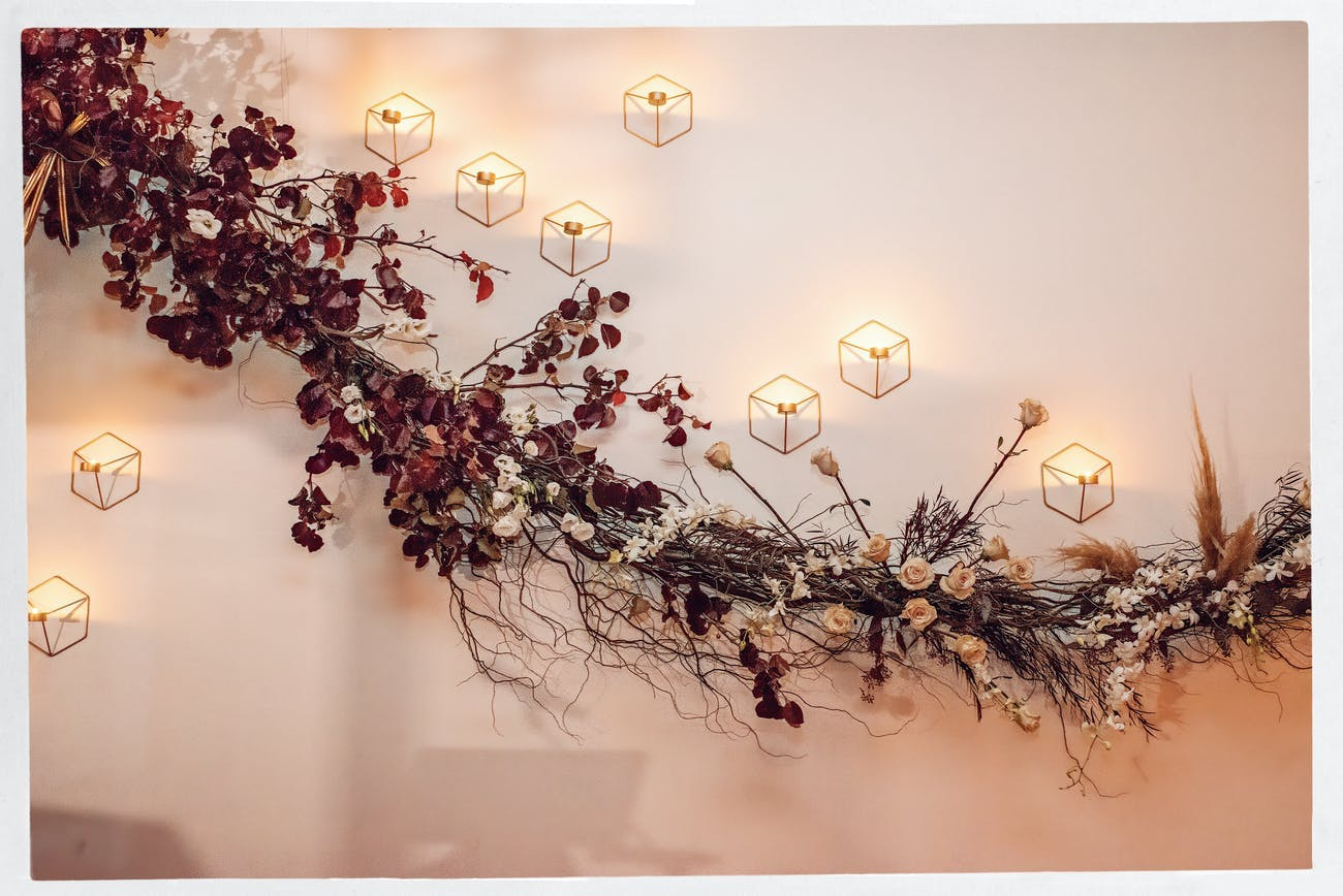 Ikebana-style fall wedding ceiling décor   PartySlate