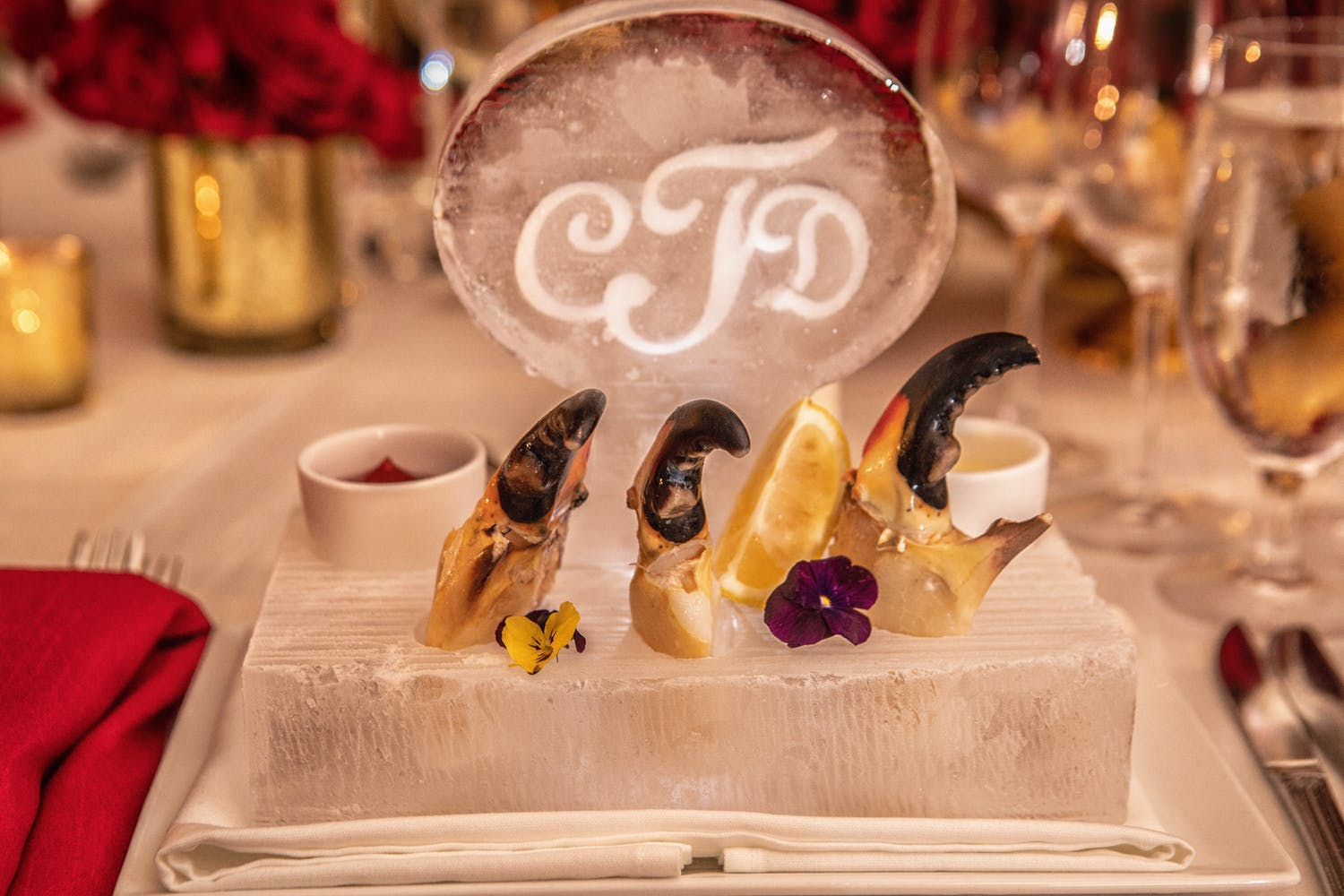 Individual mini shrimp cocktail, monogrammed ice sculpture on dinner plate at micro wedding   PartySlate