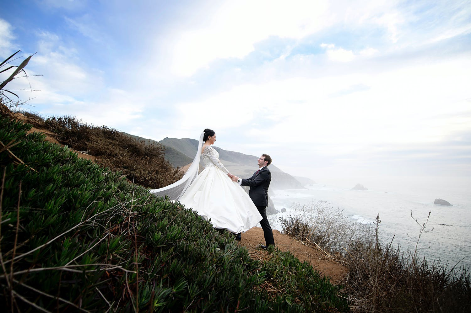 Couple poses on 17-Mile Drive including Pebble Beach between their micro wedding ceremony and private reception dinner   PartySlate