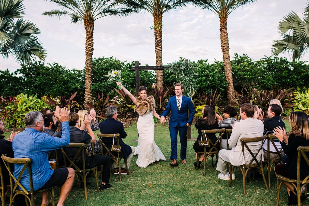 Tuscany-inspired wedding recessional of bride and groom   PartySlate